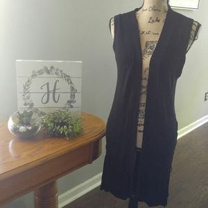 Black knit vest with lace up sides